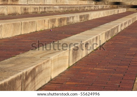 Sandstone and brick outdoor steps from a low angle