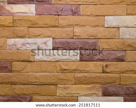 Sandstone Bricks Wall showing Natural Color and Texture, Horizontal Pattern, Sand stone wall surface, background of decorate - stock photo