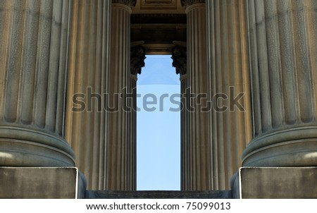 Sandstone columns on crown court building - stock photo