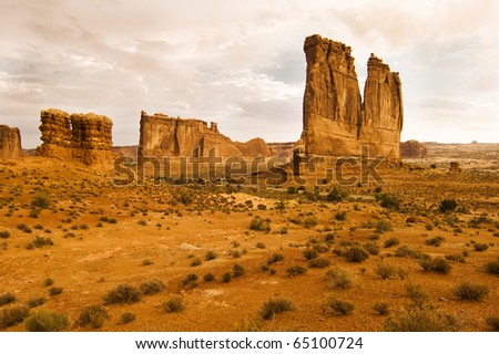 Sandstone formations are bathed in early morning light in Arches National Park near Moab Utah. - stock photo