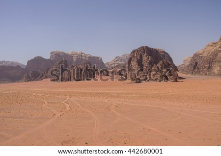 Sandstone mountains and sand dune of Wadi Rum desert (Valley of the Moon), Jordan. UNESCO World Heritage.  - stock photo