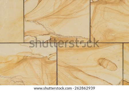 Sandstone panels on the building wall with a natural decorative pattern - stock photo