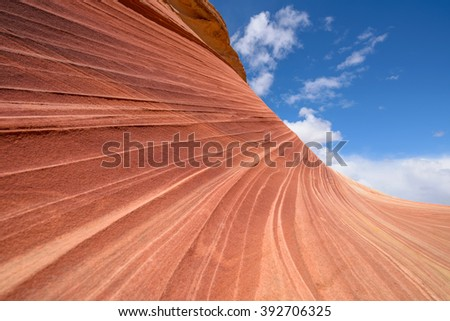 Sandstone Rock and Sky - Red sandstone rock against blue sky at The Wave - a dramatic and colorful erosional sandstone rock formation located in North Coyote Buttes area at Arizona-Utah border.  - stock photo