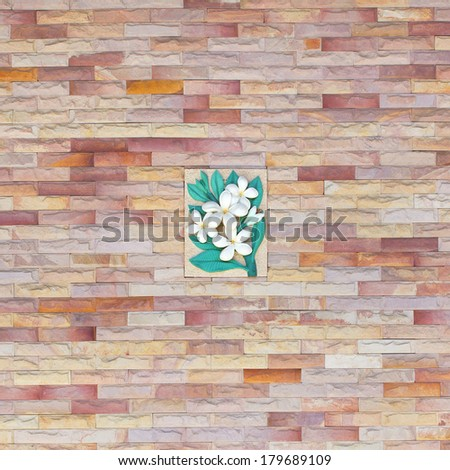 sandstone wall with  stone sculpture flower craft art design  - stock photo
