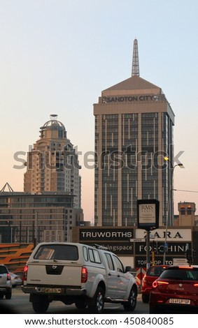 SANDTON, SOUTH AFRICA - May 19, 2016: View of Sandton City Shopping Mall and the Michelangelo Towers,  with peak afternoon traffic along Rivonia Road in the foreground.