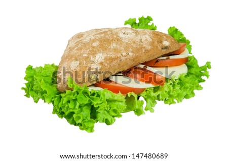 Sandwich - a bread roll with mozzarella, tomato and lettuce fillings.