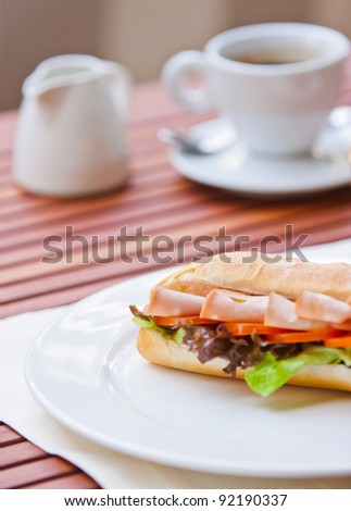sandwich  bacon with coffee on wood background. - stock photo