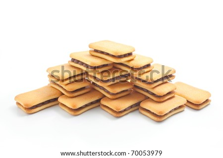 Sandwich biscuits with chocolate filling arranged in the shape of a pyramid isolated on white background - stock photo