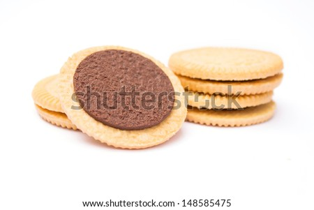 sandwich biscuits with chocolate filling on white background - stock photo