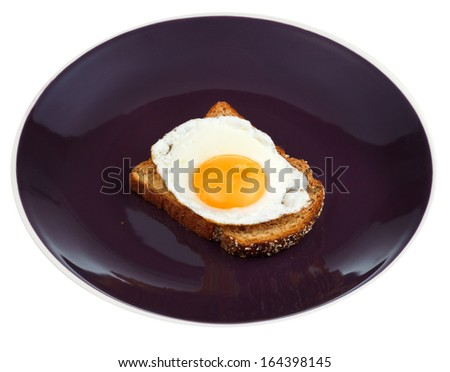 sandwich from fried egg and toasted rye bread on plate isolated on white background - stock photo