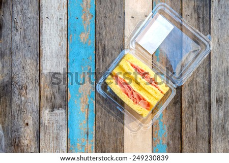 sandwich ham cheese in the box on the table - stock photo