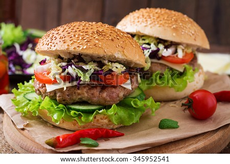 Sandwich hamburger with juicy burgers, cheese and mix of cabbage - stock photo