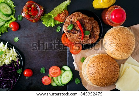 Sandwich hamburger with juicy burgers, cheese and mix of cabbage. Top view - stock photo