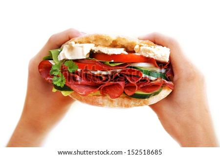 sandwich in hands over white - stock photo