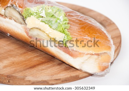 Sandwich in plastic nylon. - stock photo
