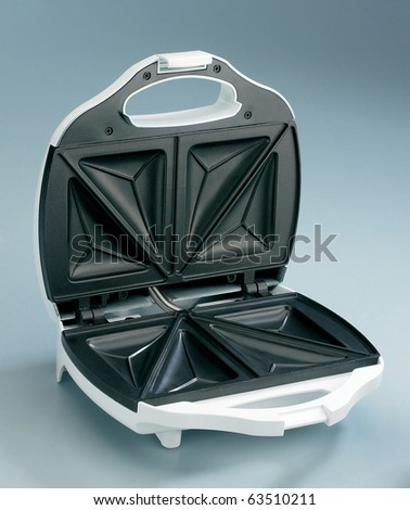 sandwich maker opened shot from a higher level. - stock photo