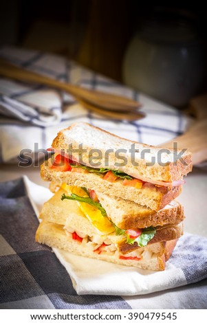Sandwich on wood table with spot lighting,shallow Depth of Field,Focus on sandwich.