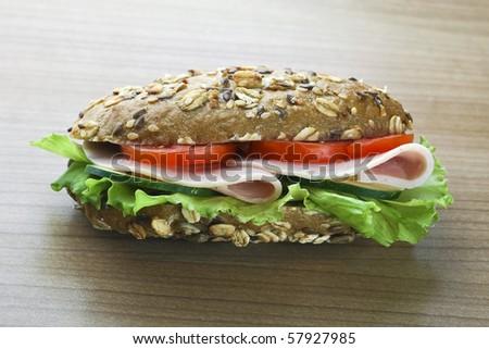 sandwich on wooden board - stock photo