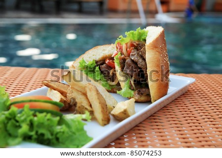sandwich outdoor near by swimming pool - stock photo