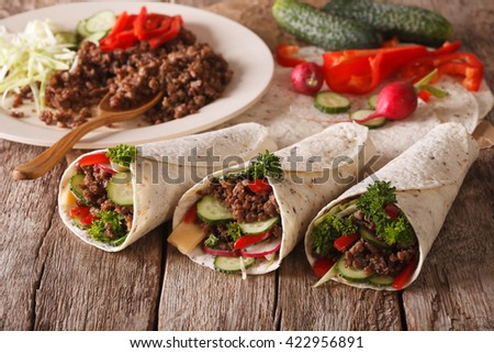 Sandwich roll stuffed with beef and vegetables close-up on the table. horizontal - stock photo