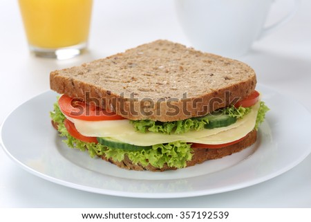 Sandwich toast bread for breakfast with cheese and orange juice, tomatoes, lettuce