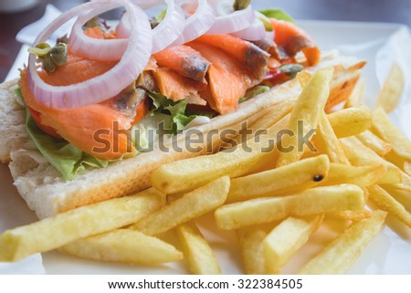 Sandwich tuna with french fries, selective focus point - stock photo