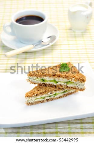 Sandwich with a cucumber - stock photo