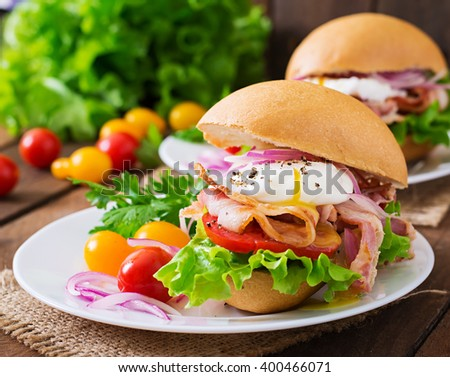 Sandwich with bacon and poached egg - stock photo