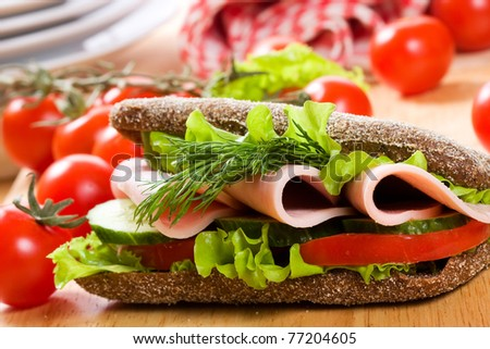 sandwich with bacon and salad - stock photo