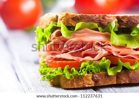 sandwich with bacon and vegetables - stock photo