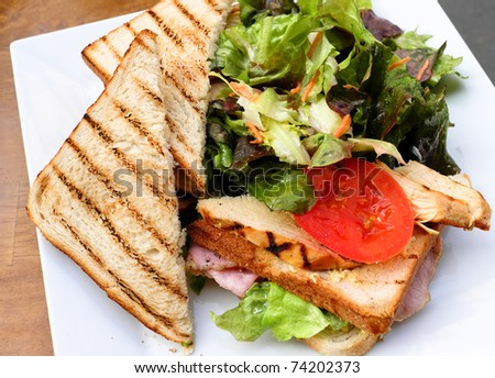 Sandwich with bacon - chicken, cheese and lettuce - stock photo