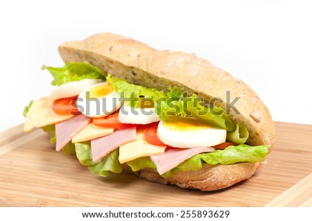 Sandwich with bacon, tomato, and cheese on white background