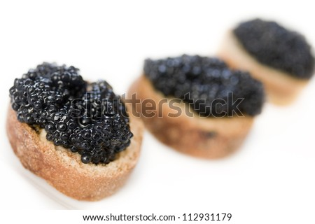 Sandwich with black caviar isolated - stock photo