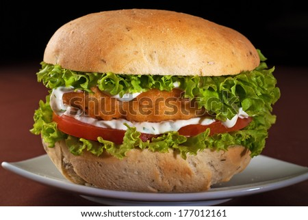 Sandwich with breaded fish - stock photo