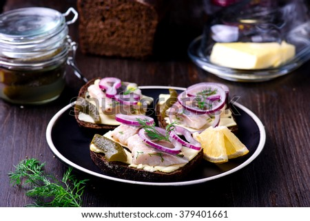 Sandwich with butter, herring, red onion, and thyme