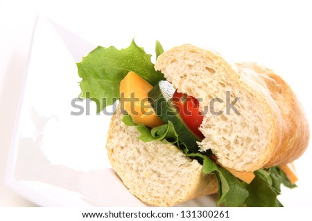 Sandwich with cheese, cucumber, tomato and lettuce