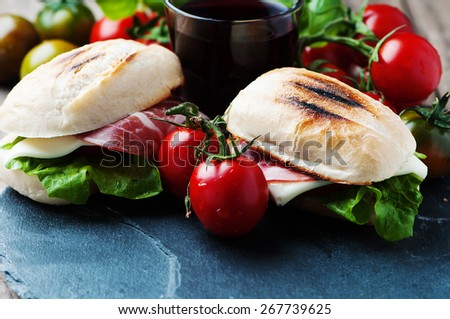 Sandwich with cheese, ham and vegetables, selective focus - stock photo