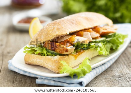 Sandwich with chicken and mango chutney - stock photo