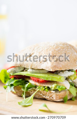 Sandwich with chicken and strawberry - stock photo
