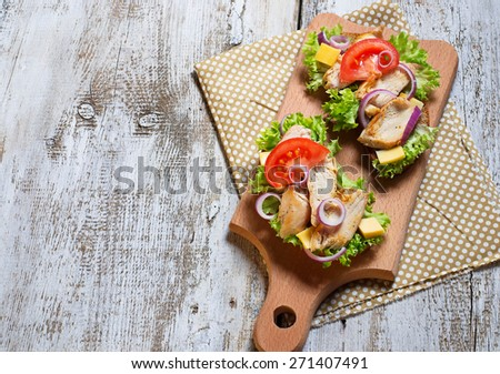 Sandwich with chicken, salad, onion and tomato. Top view. Selective focus. Copy space background - stock photo