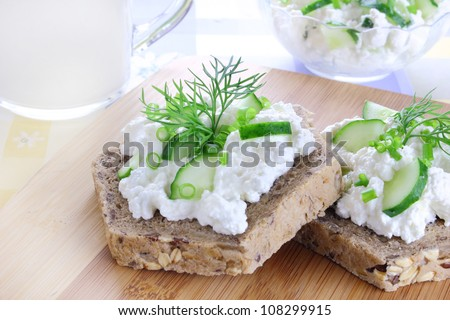 Sandwich with cottage cheese, cucumber and chives - stock photo