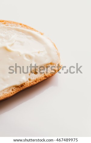 sandwich with creamy melted cheese close-up on a light background.