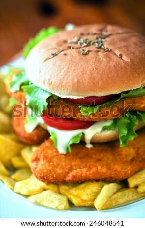 Sandwich with cutlet and fried potatoes - stock photo