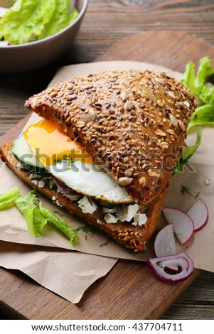 sandwich with egg and salad, food close-up