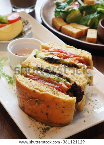 Sandwich with fresh smoked chicken, cheese and lettuce  - stock photo