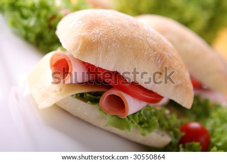 Sandwich with fresh vegetables, ham and cheese - stock photo