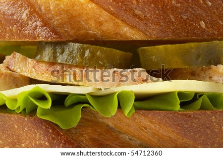 Sandwich with fried chicken and pickle cucumber macro shot background