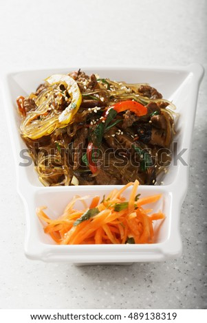 Sandwich with grilled beef, vegetables and kimchi. Shot over white with shadow