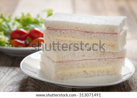 Sandwich with ham and cheese. - stock photo