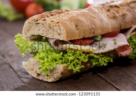 Sandwich with Ham and Cheese decorated with freh vegetables - stock photo